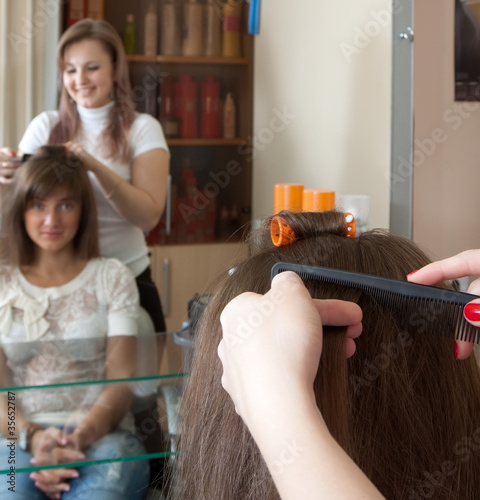 Female hair stylist is working