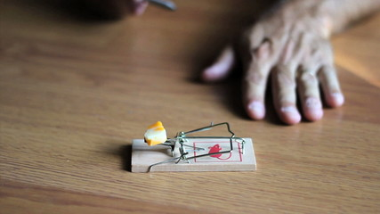 Man Testing A Mouse Trap