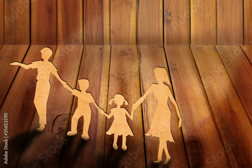 Warmth family concept, make for cut out of paper on wood texture
