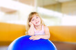 child little girl with gym aerobics ball
