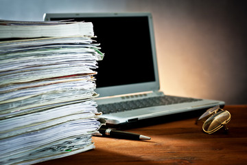 newspaper,document and laptop
