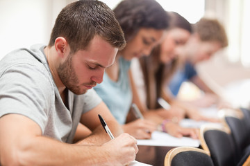 Serious students sitting for an examination