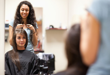 Woman combing the hair of a customer