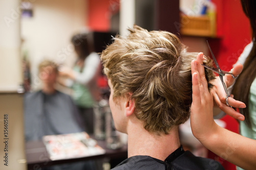 Blond-haired man having a haircut