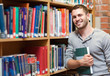 Smiling male student holding a book