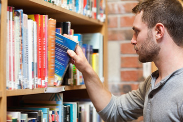 Male student picking a book