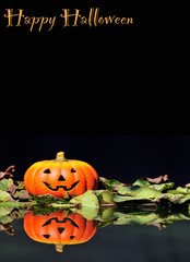 Calabaza de Halloween sobre fondo negro.