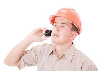 Businessman in helmet on the phone.
