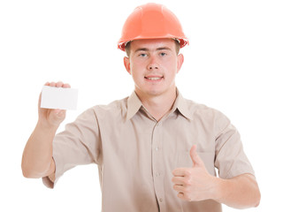 Businessman in helmet with visit card in his hand.