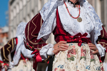 Sardinia, Italy: Redentore festival. Detail of a dress