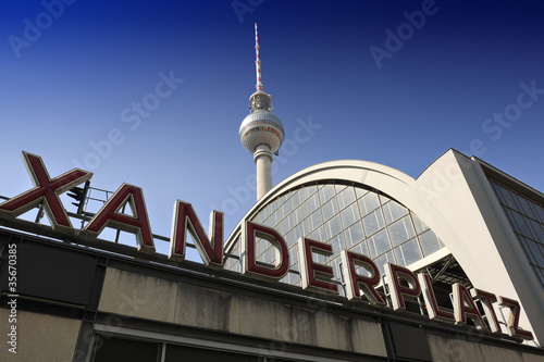 Alexanderplatz station sign and the TV Tower in Berlin