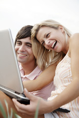 happy couple with laptop