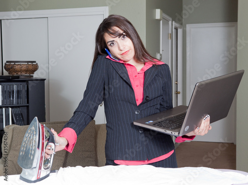 Stern Hispanic multitasking business woman housewife