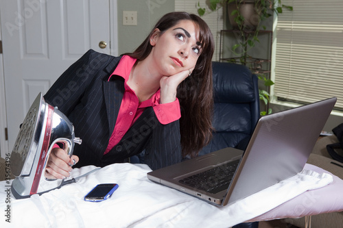 Overwhelmed Hispanic home based businesswoman
