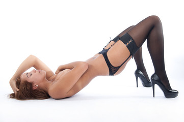 Sexy woman on the floor showing pleasure