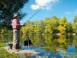 Senior fisherman catches a fish