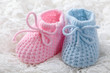 Blue and pink baby booties on white background - 35680538