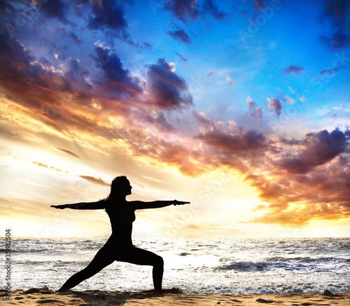 Yoga silhouette warrior II pose