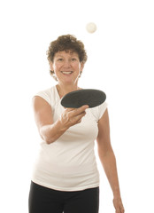 active middle age senior woman playing ping pong
