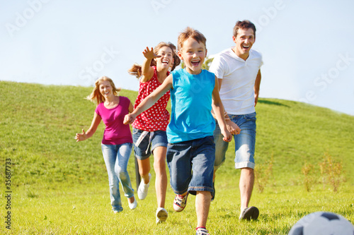 Happy family running