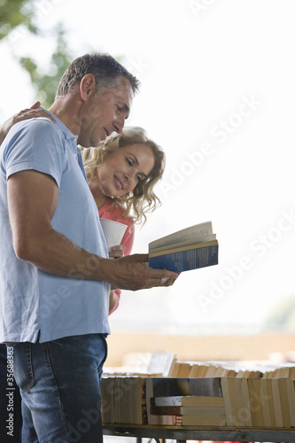 A couple looking at books at a book stall
