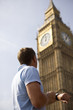 A man checking his watch next to Big Ben