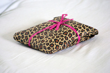 gift wrapped in leopard print with pink ribbon