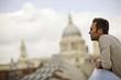 A man on the Millennium Bridge, admiring the view