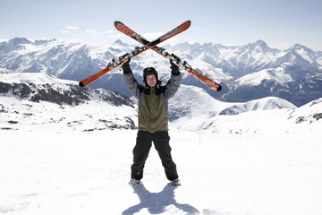 Man holding skis up