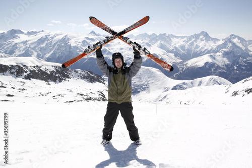 Man holding skis up