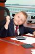 Cute goofy boy in business attire in an office