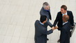 High angle view of cooperative business men shaking hands