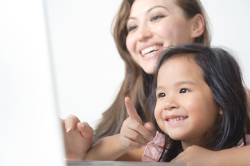 Little Girl Pointing at laptop happy