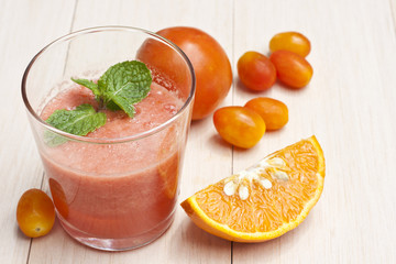 Tomatoes with orange juice