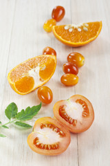 Tomato vegetable with orange fruit
