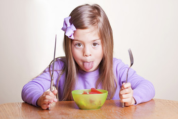 Cute little girl not wanting to eat healthy food