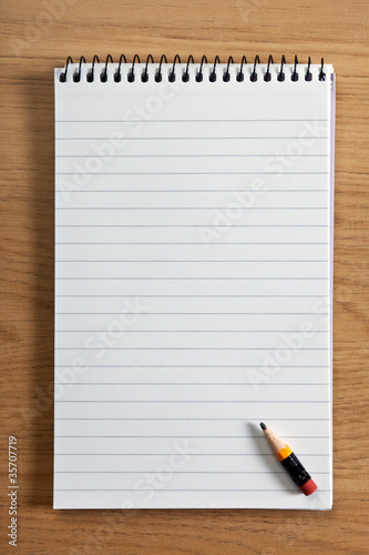 Blank notepad and pencil