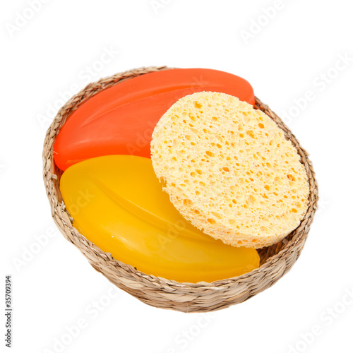 colorful soap and sponge in a woven basket