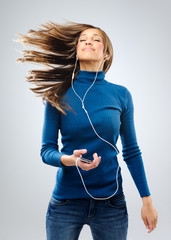 Happy woman with music player