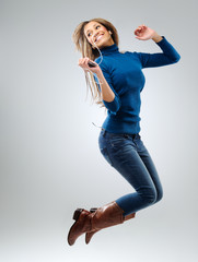 Energetic woman with music player