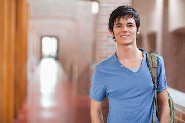 Smiling male student posing