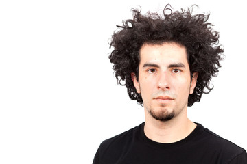 Handsome young man with long curly hair and goatee