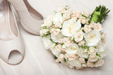 Wedding bouquet and bride's shoes