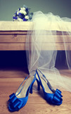 Wedding bouquet and blue bride's shoes
