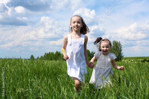 two little sisters outdoors