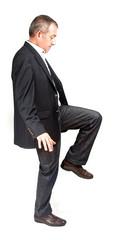 Businessman on single foot