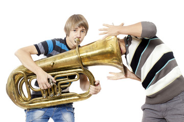 Fun boys enjoy with a trumpet