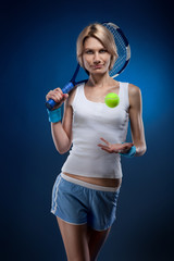smiling woman with a tennis ball and racquet on blue