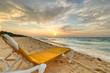 Empty deckchair on the Caribbean Sea at sunrise