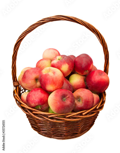 Apples in basket isolated
